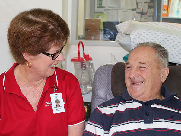 volunteer chatting with patient
